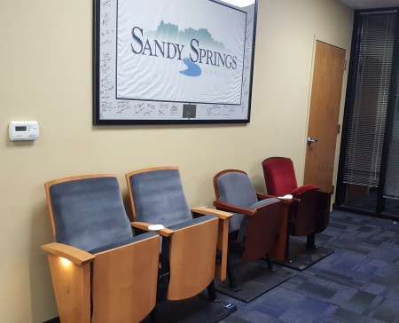 Sample theater seats installed in the Sandy Springs City Council chambers for officials to test as models for the future City Springs performing arts center. (Photo John Ruch)