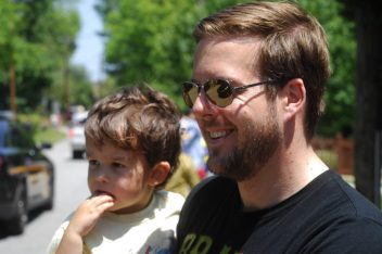 """Osborne Road; Saturday May 6, 2016 12:00pm. Forty Third Annual """"Lynwood Days Parade and Festival"""". The parade started at the Lynwood Park United Christian Church and traveled to Windsor Parkway then turned north on Osborne Road and finished in Lynwood Park. Lynwood residents Justin Carpenter, and his son Logan Carpenter (2yr)."""