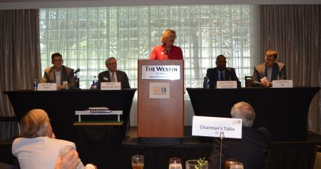 Yvonne Williams (standing, center), president and CEO of the Perimeter Center Improvement Districts, speaks as part of the May 13 Perimeter Business Alliance discussion on alternative transit systems with panelists (from left) Ben Limmer of MARTA; Bill Owen of Owen Transit Group; Kenneth William of Hartsfield-Jackson Atlanta International Airport; and Cain Williamson of the Atlanta Regional Commission. (Photo John Ruch)