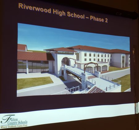 An early conceptual illustration of a pedestrian bridge at the future new Riverwood school displayed at the May 23 meeting. Architect Bob Sussenbach noted it lacks many real-life details, such as trees. (Photo John Ruch)