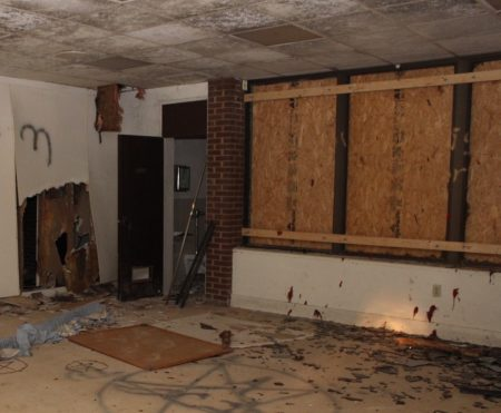 Graffiti and debris fill many of the former classrooms. (Photo Dyana Bagby)