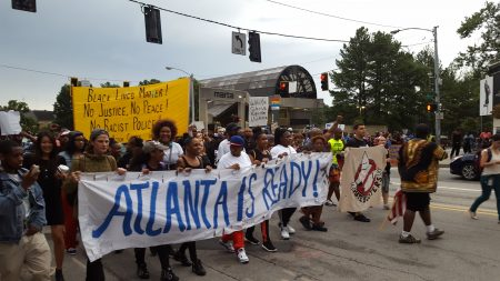 The protest march begins on Lenox Road from the Lenox MARTA Station. (Photo John Ruch)