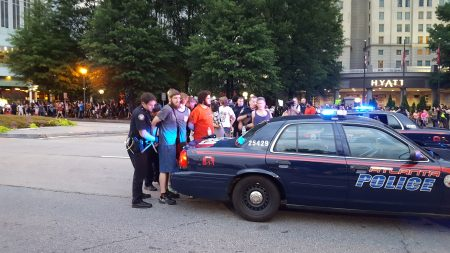 Protesters are arrested on Peachtree Road. (Photo John Ruch)