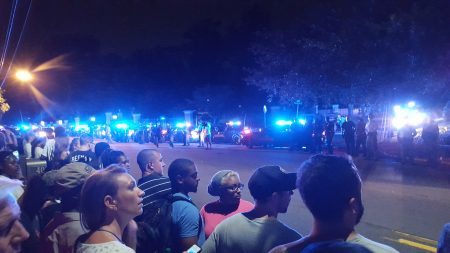 Protesters and police watch each other across West Paces Ferry Road at the Governor's Mansion. (Photo John Ruch)
