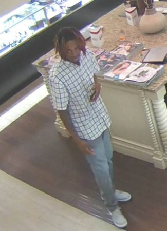 Atlanta Police released this image of a person of interest in the June 29 shooting at Lenox Mall. (APD)