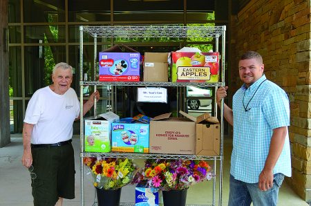Tom Umstead, left, receives donations of food and flowers and delivers all to local charities.