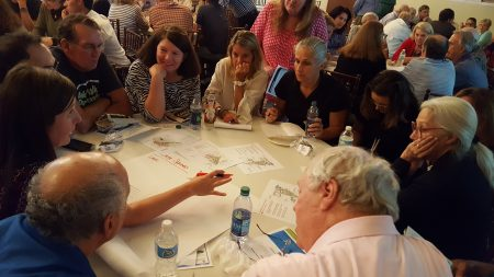 Residents brainstorm with a Next Ten planner at the MARTA station small area plan meeting July 18 at Heritage Hall. (Photo John Ruch)