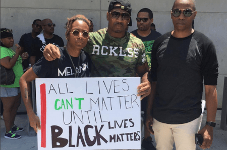 """A photo of the Lenox Square Mall protesters, including Stevie J. (center), posted by """"trm_hippyninja_3000"""" on Instagram."""