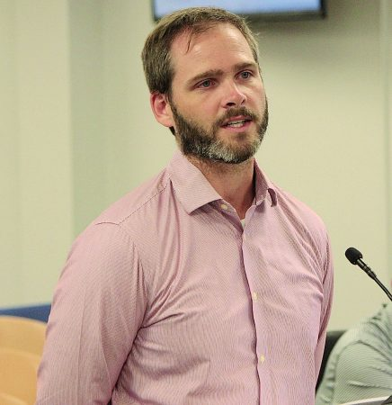 Rev. Zach Bradley read a letter at a recent City Council meeting urging members to make a place for affordable housing as the city continues to grow. (Photo Dyana Bagby)