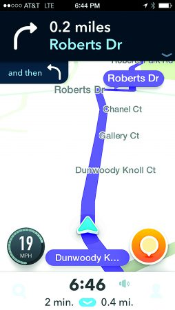 A screenshot of the Waze app directing a driver down Dunwoody Knoll Drive in Dunwoody.
