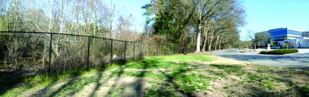 A current view of a stretch of the proposed Peachtree Creek Greenway. A fence blocks access to the creek. (Heath & Lineback Engineers)