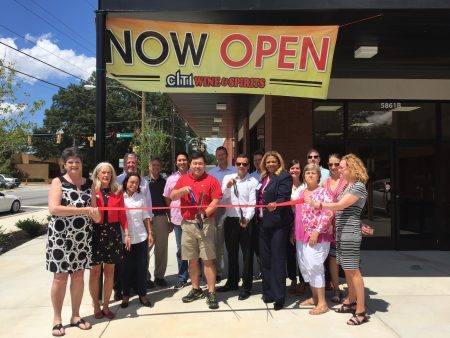 Bobby Yun, center, owner of Citi Wine & Spirits located at 5861 Roswell Road in Sandy Springs, cut the ribbon on Aug. 15 in front of Sandy Springs Chamber members, employees and friends. (Special)