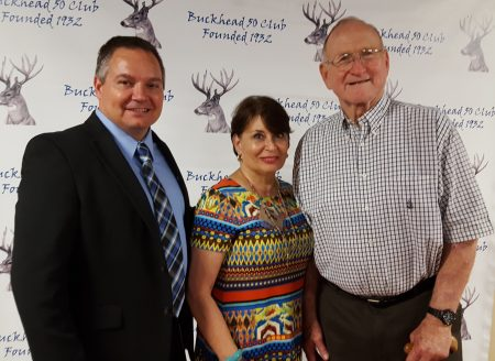 (from left) Dave Ward, president and CEO of Nobis Works; board member Lynn Nobis; and board member and former Falcons great Tommy Nobis pose after the Buckhead 50 Club meeting at Chastain Park Aug. 9. (Photo John Ruch)