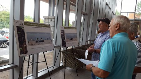 Residents examine the Ashford-Dunwoody Road corridor improvement proposals during the Sept. 12 open house at Marist School. (Photo John Ruch)