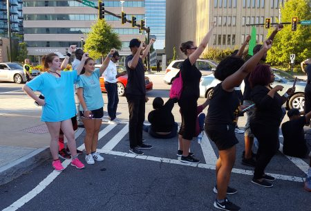 A young trio of white teens join the protest. (Photo John Ruch)