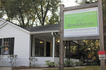 """The """"Little White House"""" as it looked in 2012, when Brookhaven's new city government met inside it. (File Photo)"""