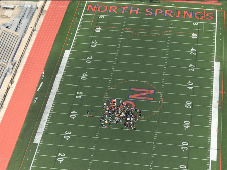 Protesters on the North Springs High School football field. (CBS46)