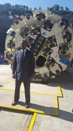 "Mayor Kasim Reed poses with the ""Driller Mike"" tunnel-boring machine at Bellwood Quarry Sept. 21 in a photo from the drill's Twitter account."