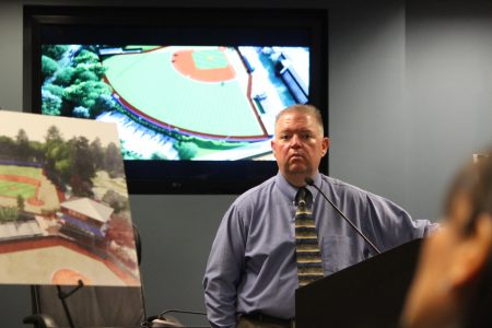 Dunwoody Finance Director Chris Pike discusses plans for a land swap with the DeKalb County School District at an Oct. 17 public meeting. (Photo Dyana Bagby)