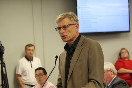 Jack Honderd, an architect who supports building housing near public transportation, urged the City Council to approve MARTA's rezoning request. (Photo Dyana Bagby)