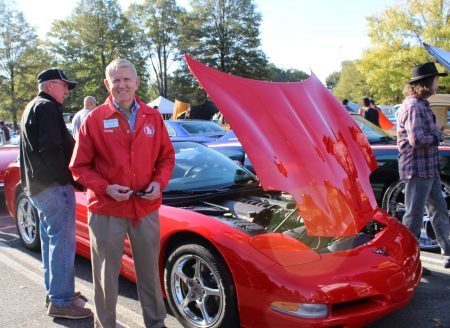"""Dunwoody Mayor Denis Shortal shows off his """"red, red and more red"""" Corvette at the car show. (Photo Dyana Bagby)"""