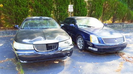 Damaged cars parked on Nov. 1 in the lot at the North Fulton Government Services rented by Classic Cadillac and Subaru. (Photo John Ruch)