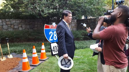 Sandy Springs Mayor Rusty Paul speaks to reporters after the Nov. 3 I-285/Ga. 400 groundbreaking ceremony at the Concourse Center. (Photo John Ruch)
