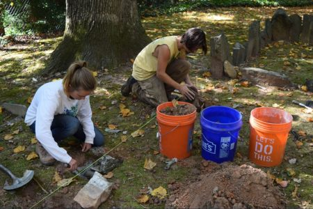 A rehabilitation team works on Harmony Grove Cemetery at West Paces Ferry and Chatham roads, one of Buckhead Heritage Society's ongoing projects. (Special)