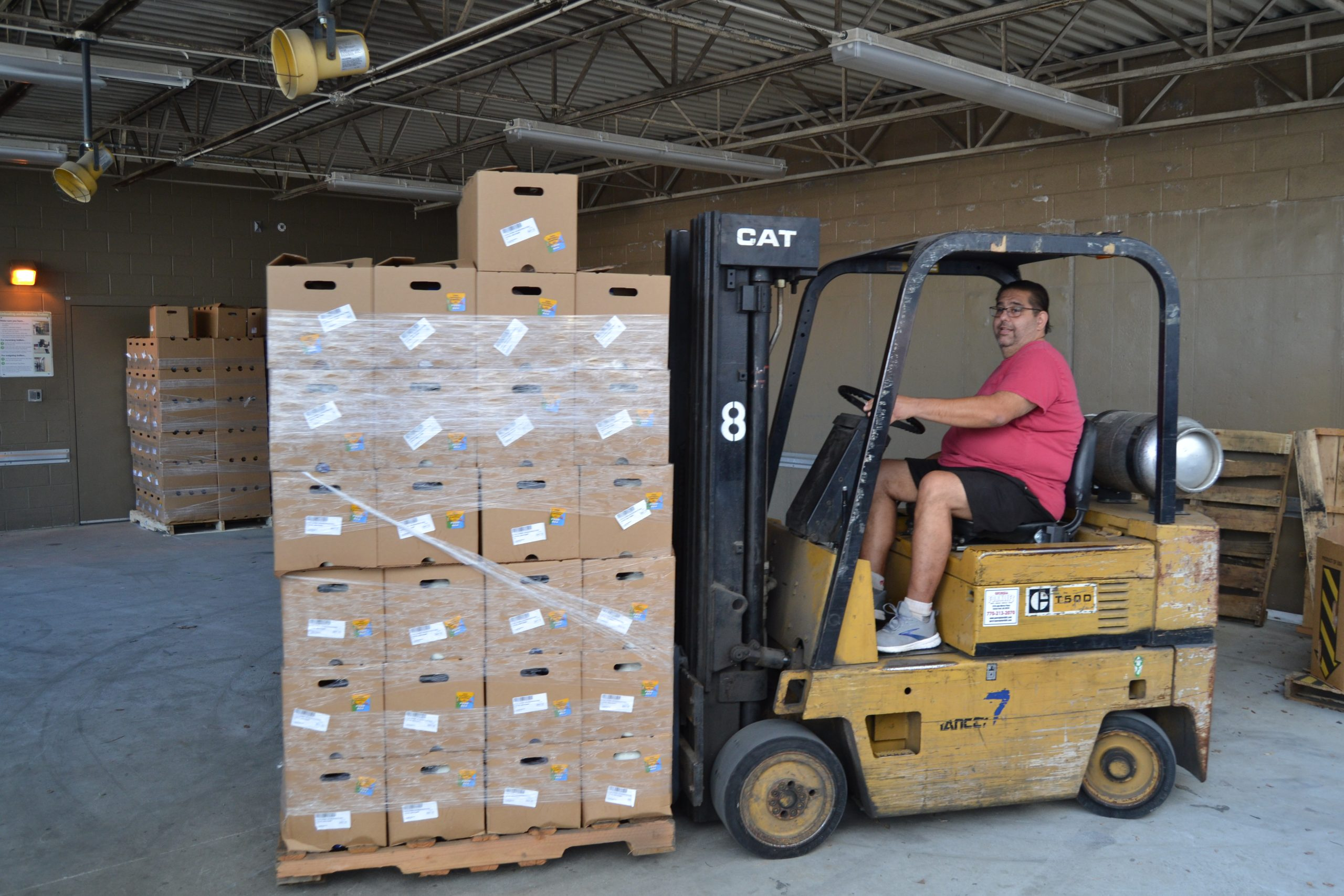 Unloading USDA Food Boxes with forklift at Solidarity Sandy Springs.