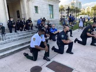 Miami Police bows to pressure, knelt down on the street to beg crowds over George floyed death