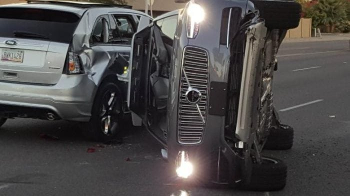 A self-driven Volvo SUV owned and operated by Uber Technologies Inc. is flipped on its side after a collision in Tempe, Arizona, U.S. on March 24, 2017. Courtesy FRESCO NEWS/Mark Beach/Handout via REUTERS