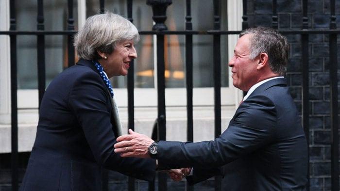 Theresa May greeting King Abdullah II of Jordan when he visited London