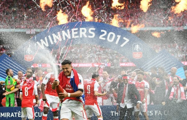 epa05994051 Arsenal's Alexis Sanchez (C) celebrates after the English FA Cup final between Arsenal FC and Chelsea FC at Wembley in London, Britain, 27 May 2017. Arsenal won 2-1. EPA/FACUNDO ARRIZABALAGA EDITORIAL USE ONLY. No use with unauthorized audio, video, data, fixture lists, club/league logos or 'live' services. Online in-match use limited to 75 images, no video emulation. No use in betting, games or single club/league/player publications.
