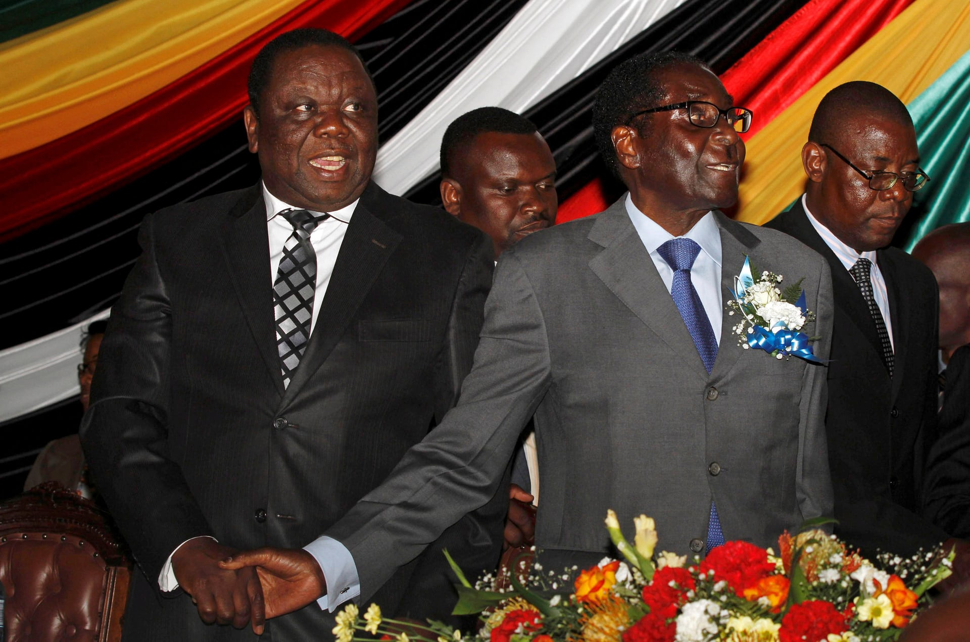 Tsvangirai, left, and Robert Mugabe at a conference reviewing a draft constitution in Harare in October 2012. Photograph: Philimon Bulawayo/Reuters