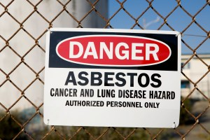 A typical asbestos warning sign. Though asbestos is present in many public and private buildings, signs like these are usually displayed in renovation zones where asbestos may not be contained and protective precautions are needed.