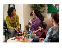 women and children talking
