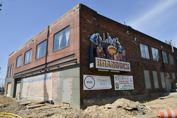 The town's mayor had converted this former car dealership. He and his family lives on the second floor. A friend is opening a restaurant on the ground floor