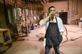 Asa Foster samples the goods at his brewhouse, The Brew Gentleman Beer Company. Foster and his business partner Matt Katase established the business after graduating from Carnegie Mellon University.