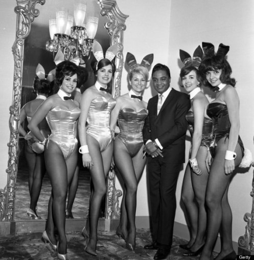 NEW YORK - NOVEMBER 19: Rock and roll singer Jackie Wilson poses for a portrait with a group of Playboy Bunnies at a dinner for the Motion Picture Pioneers Association at the Playboy Club on November 19, 1962 in New York, New York. (Photo by PoPsie Randolph/Michael Ochs Archives/Getty Images)