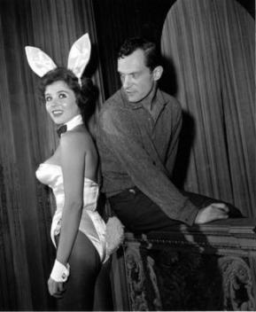"""In the beginning ... Hugh Hefner poses with """"bunny-girl"""" hostess Bonnie J. Halpin at his Playboy nightclub in Chicago, on June 20, 1961."""