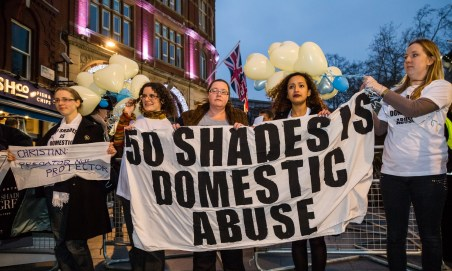 """""""Fifty Shades of Grey"""" premiere domestic abuse protest in London"""