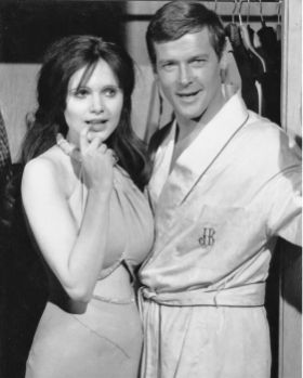 Roger Moore and Madeline Smith