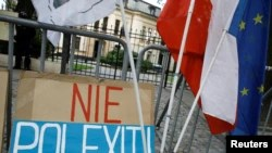 """A banner reading """"No polexit"""" is pictured outside the Constitutional Tribunal building during a demonstration in Warsaw, Poland on Sept. 22, 2021."""