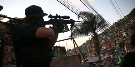 Top photo: An officer from the CORE police special forces aims his weapon during an operation to search for fugitives in the Complexo do Alemao favela on May 13, 2014, in Rio de Janeiro, Brazil, one of the world's megacities. A Pentagon video forecasting the future of the world's urban populations suggests that the U.S. military is fundamentally ill-equipped for future battles in megacities.