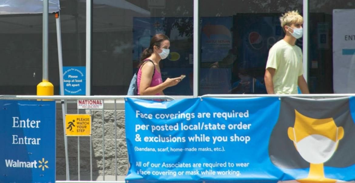 To Mask Or Not To Mask? Confusion Swirls Among Shoppers After CDC Issues New Guidance
