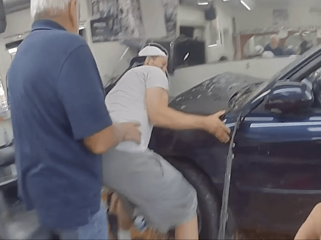 Cops, Bystanders Rescue Mom and Baby Trapped Under Car