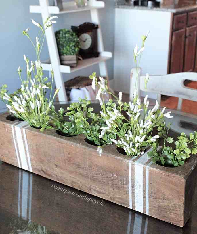 how to decorate vintage style with a sugar mold and grain sack stripes