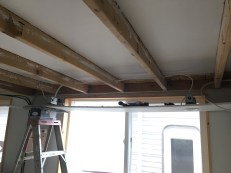 Had to balance the soffit board on a couple of ladders to get it up to the ceiling.