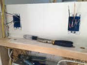 A future entry shelf area with outlet and decorative LED lighting switch.