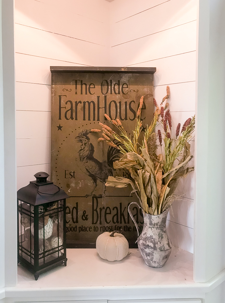 Corner cabinet with farmhouse sign and fall decor